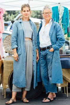 "27 Rad Street-Style Snaps From L.A.'s Rose Bowl Flea Market #refinery29  http://www.refinery29.com/2015/05/87815/rose-bowl-flea-market-street-style-pictures#slide-18  Name: Jenni Williams (left) and Rosemary Warren (right)Job: Co-Owners, Market VintageWilliams is wearing a vintage Orvis denim duster and Carole Little pants with a cotton top.Best flea market buy to date: ""An L.A. Occidental College yearbook from 1959. The images of classmates and their style of the time was right on ..."