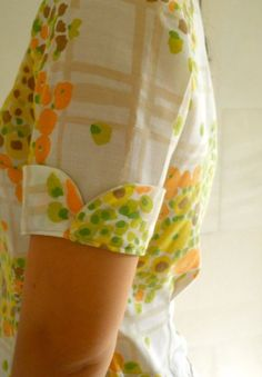 vintage sheet shirt and petal cuffs- I have a fantastic sheet for re-purposing, I imagine I would want it to be turned into something like this.however I am not much of a seamstress, perhaps someone else would like to make it happen Kurti Sleeves Design, Sleeves Designs For Dresses, Kurta Neck Design, Dress Neck Designs, Blouse Designs, Sleeve Designs For Kurtis, Kurta Designs Women, Salwar Designs, Sewing Sleeves