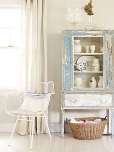 When this homeowner took a sander to this once-white hutch, she uncovered a striking shade of Robin's egg blue.