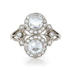 Diamond Ring with two Rose Cuts :: The fashionable vintage look is created by the delicate detail surrounding a pair of classic rose cut diamonds. $7,550