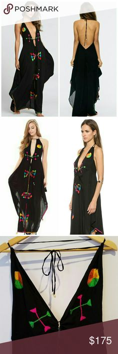 Indah Embroidered Maxi This dress is breathtaking! Perfect cover-up for a resort/beachy vacation. Black with multicolor embroidery and tassels. Open back, deep v on front, slit on sides. Picture included with sides taped up to give the full affect. NWOT, perfect condition. Indah Dresses