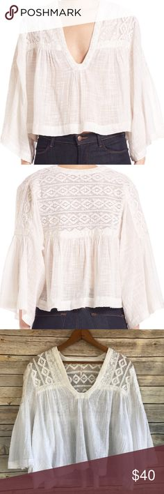 Free People Tunic Top ✌🏽🌈 NWOT Free People Tunic Top. Cream color gauze material w/crochet detailing top front & back shoulder area. Flare flutter 3/4 sleeves. Brand new, never worn. Would be adorable dressed up or just as casual wear, very versatile. N🚫 Trades. ☀️🏄🏽♀️🌴 ps keep in mind juniors sizing runs smaller. Free People Tops Tunics