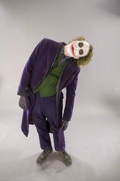 We are bowled over with the amazing detail in this collection of forgotten Dark Knight promo shots. Specifically these gorgeous images of The Joker — the detail on Heath Ledger's costume, face, gloves, it's beautiful. There's even remnants of white face paint on his coat, and the orange lining inside it's all amazing.
