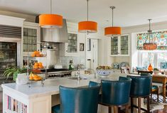 Kitchen Chairs: Bright Orange Drum Shade Hanging Lights And Teal Chairs For Open Kitchen Decoration Ideas With White Cabinet And Island. Teal Kitchen Chairs for Shabby and Minimalist Decoration Teal Color For Kitchen Decoration, Designer Kitchen Chairs, Orange Kitchen Decor, Teal Kitchen, Kitchen Colors, Kitchen Ideas, Space Kitchen, Kitchen Tops, Open Kitchen, Country Kitchen, Diy Kitchen