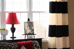Beautiful diy curtains which are no-sew drapes with bold stripes. Your windows will love you!  Found via TipJunkie.com