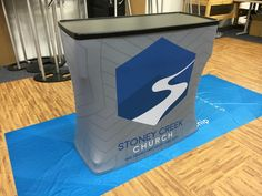 Stoney Creek Church in Goldsboro NC uses this as a  hospitality desk. The name of church and logo is all that is needed to brand it, but also generic enough to use for any event. After use, the wrapper slides off and it becomes a rolling storage case for all their supplies.