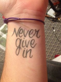 My tattoo inspired by my favorite band Black veil brides. It's a reminder to me everyday to never give in or back down and to fight against all odds. I have it on the same arm where my scars are from when I used to cut. So simple yet it means so much.