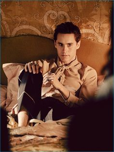 Behind the Scenes: Wearing a silk shirt and scarf from Gucci, Jared Leto relaxes…