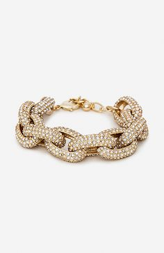Link bracelet featuring all over embossing and pavé-set inlays that sparkle from every angle. 7.5 inches Lobster Claw Closure