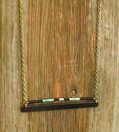 Turquoise  Brass Bar Necklace | This short, brass bar necklace features heishi turquoise and m... | Necklaces