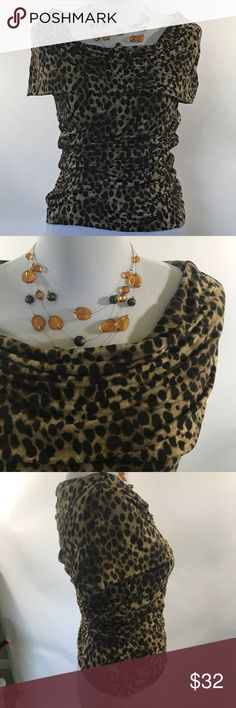 Michael Kors Leopard print top with shawl collar M Michael Kors knit top. Fabric is a rayon spandex. This top is a leopard print with shirring on the sides for a flattering fit. It is sleeveless and has a deep shawl collar that can be worn over the shoulders. Please see picture for garment measurements and details. Thanks for visiting my closet! MICHAEL Michael Kors Tops