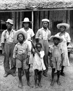 Alfred Eisenstaedt, Delta and Pine Company African-American sharecropper (tenant farmer) Lonnie Fair and his family outside of their house, Scott, Mississippi, USA, October 1936.