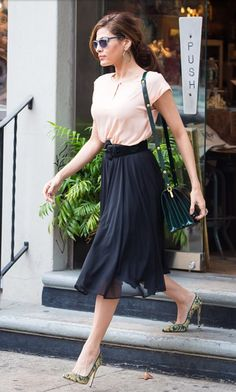 Eve Mendes accessorised her full skirt and pink top with a Marni bag and Bionda Castana heels, NY, October 2013