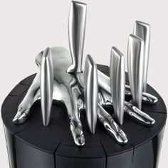 "Seen ""Aliens?""  This would be the part of Bishop's knife trick that went wrong!  Pretty, but seems as if its would be a chore to keep clean...  - Five Finger Fillet Knife Set"