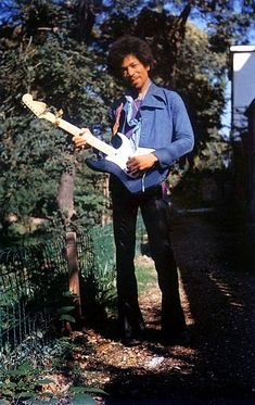"""Sept 17th, 1970. Samarkand Hotel, London. The Last Photos of Jimi Hendrix- Monika took photographs of him holding his favorite Fender Stratocaster guitar that he called the """"black beauty""""."""