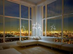 I'm not a big fan of modern homes but this apartment view is just glorious! imagine coming home to that view every night- it makes my heart flutter!