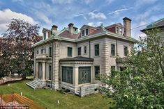 Sprawling: The historic mansion in Scranton, first built in 1910, is the former home of Charles Sumner 'Sum' Woolworth, who created the now-defunct chain of stores with his brother, has been put on the market for just $295,000