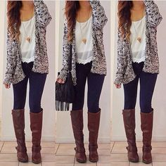 Black and gray sweater, dark slim fit jeans and tall brown leather boots.