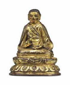 A GILT-BRONZE FIGURE OF A LAMA TIBET, LATE 15TH CENTURY Seated with legs crossed on a lotus base, his right hand in vitarkamudra, his left hand resting on his lap, dressed in various garments, his cold-gilded face displaying a serene expression, resealed 4 ½ in. (11.5 cm.) high