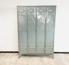 This industrial locker was originally sourced from a textile factory in France. The locker is riveted and in the original color with diamond shaped details. The locker is in a good vintage condition with one dent on the back (see photos) and normal wear consistent with age and use.