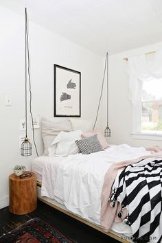 pink + white bedroom with black stripes