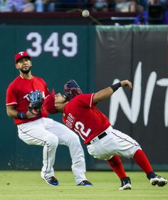 Texas Rangers second baseman Rougned Odor (12) leans back to catch a fly ball by Nelson Cruz as outfielder Nomar Mazara runs in during the first inning of their game against the Seattle Mariners on Saturday, June 4, 2016 at Globe Life Park in Arlington, Texas. (Ashley Landis/The Dallas Morning News)