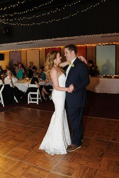 """First Dance to Adam Sandlar's """"Grow Old With You"""". From Paul & Amy's Simple, Blue & Yellow Frederick Maryland Wedding at The Faux School. Images by Rachel Harrod Photography."""