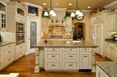 Antiqued white cabinets. Seriously thinking about doing this. Would go beautifully with our home.
