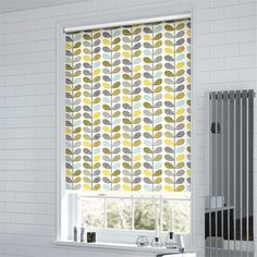 One of Orla's signature patterns, the stem design climbs this fabric in orderly columns for a delightfully different vertical stripe pattern that bounces with cheerful style.  The muted colourway keeps the look balanced and natural, with deep greens, pastel blue and crisp grey interspersed with flashes of sunny yellow  The robust PVC material also gives this blind a truly practical edge, making it 100% waterproof and wipe-clean. Waterproof Blinds, Pvc Material, Roller Blinds, Pastel Blue, Scribble, Cleaning Wipes, Things That Bounce, Kitchen Design, Colours