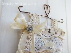 """I'm always looking for fun ways to store things in my creative space that are both visually inspiring and useful. I think this pretty three pocket hanger made with vintage doilies and scraps of natural fabrics meets the requirement perfectly.   Materials 6"""" Rusty hanger, Vintage doilies in a variety of sizes, Assorted natural …"""