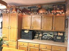 Primitive kitchen decor and above cabinets decor Above Cupboard Decor, Decorating Above Kitchen Cabinets, Above Cabinets, Pig Kitchen Decor, Primitive Kitchen Decor, Country Kitchen, Kitchen Rustic, Primitive Country, Kitchen Ideas