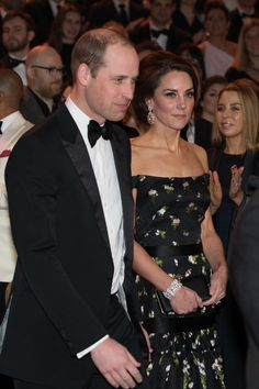 Kate Middleton Photos Photos - Britain's Prince William, Duke of Cambridge (L) and Britain's Catherine, Duchess of Cambridge arrive to attend the BAFTA British Academy Film Awards at the Royal Albert Hall in London on February 12, 2017...The British Academy of Film and Television Arts supports, develops and promotes the art forms of the moving image by identifying and rewarding excellence, inspiring practitioners and benefiting the public. / AFP / POOL / Daniel LEAL-OLIVAS - EE British…