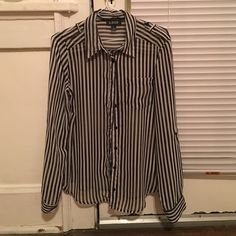 Black and white striped dress shirt! This short can be dressed up or down. The sleeves have a button under the elbow so they can be worn rolled up. Super cute and only worn once. Tops Button Down Shirts