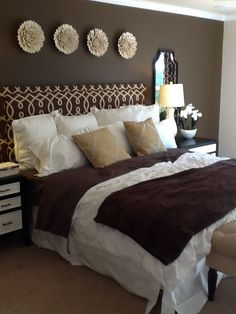 A warm and cozy bedroom with dark hardwood floors and brown paint ...