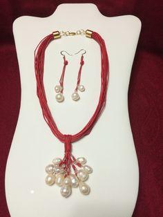 Collar con hilo acerado y colgante de perlas .creadas. en agua dulce