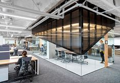 Uber SF Office, Smoked polycarbonate and frameless glass enclose meeting rooms. car rental company