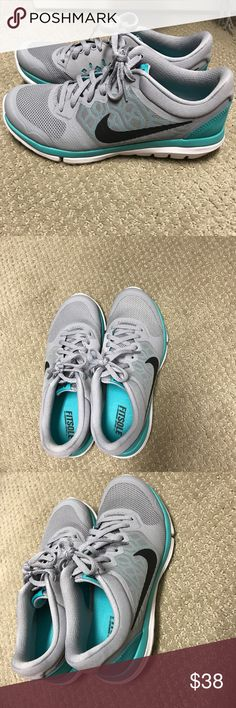 Barely worn Nike sneakers size 7.5 Nike flex sneakers. Size 7.5 and gray white and turquoise. Nike Shoes Sneakers