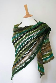crochet net lace shawl in green and rainbow. I feel like I'd need a mermaid costume to go with it , like a glam fishing net