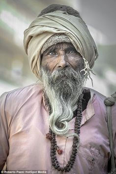 Photographer Roberto Pazzi, 42, captured these photographs of some of India's poorest residents, from street vendors in Jaipur (pictured), to holy Sadhus in Varanasi.