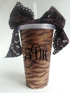 The Monogrammed Tiger Tumbler is customized to your initials, and is a great way to personalize a gift. The Giraffe Print insert is removable for washing Tumbler. The Hot Pink bowtie, is a pretty embellishment and is sure to accent your look all season! This item is also BPA Free!  At check out Please inform me of vinyl color, and initials! (Please put initials for monogram in the order you want them to appear).