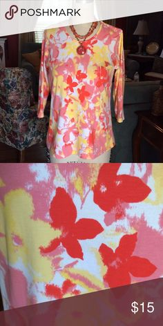 Fall Colors 3/4 Sleeve Top So bright and beautiful! Lovely with white capris in summer but great for fall days as well. D and Company Tops