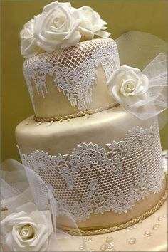 The elegance of this cake!!!  The top layer is created from the VIRGINIA cakeart mat and the bottom tier is created from the TAYLOR ROSE mat  Find these and many more at: www.allaboutcakeart.com
