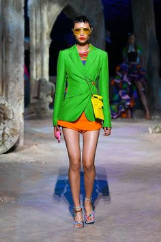 Tom + Lorenzo Sept. 29, 2020: Milan Fashion Week: Versace Spring 2021 Collection | Neon green blazer with jeweled button closure and orange shorts Fashion 2020, Runway Fashion, Spring Fashion, High Fashion, Fashion Beauty, Fashion Show, Milan Fashion, Donatella Versace, Fashion Bubbles