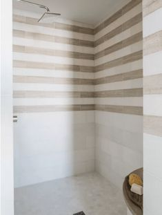 Wood look tile and marble create an organic layered look in the master bathroom that is so fresh and pretty. Wood Bathroom, White Bathroom, Modern Bathroom, Small Bathroom, Bathroom Bench, Master Bathrooms, Bathroom Cost, Beach Bathrooms, Bathroom Plants