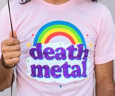 Look downright intimidating when you show up to see your favorite hardcore band wearing this death metal rainbow shirt. After all, nothing says you're a soulless monster quite like a dainty rainbow over a sea of pastel pink.