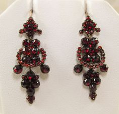 Fiery Bohemian garnets adorn these articulated Victorian earrings. The rose cut faceting of the garnets makes them glisten and sparkle as they catch the light. Garnets are the birthstone for January. During the Victorian era, garnets were one of the … More →