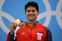 Joseph Schooling Photos - Joseph Schooling of Singapore celebrates winning the gold medal in the Men's 100m Butterfly Final on Day 7 of the Rio 2016 Olympic Games at the Olympic Aquatics Stadium on August 12, 2016 in Rio de Janeiro, Brazil. - Swimming - Olympics: Day 7