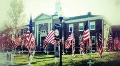 This is the courthouse in downtown, Ringgold, GA - each flag represents a local fallen hero.  The flags line each side of the street for blocks!
