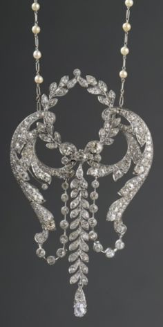 A rare Belle Epoque diamond and platinum pendant, by Mellerio dits Meller, circa 1900. Fine openwork pendant of foliate, garland and wreath motifs with a pear-shaped diamond drop below, surmounted by a laurel, set throughout with diamonds, suspended from a fine chain interspersed with fine pearls, mounted in platinum. Signed. #MellerioDitsMeller #BelleÉpoque #pendant