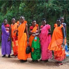 Rwanda....  these women are beautiful! Look at how beautiful these dresses are - awesome colors.... ~sf